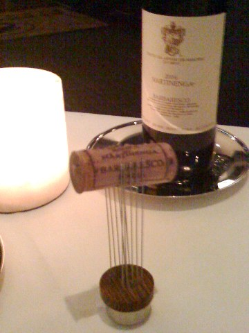 the cork pulled from our barbaresco, trapped between two rows of long pins on a small pedestal