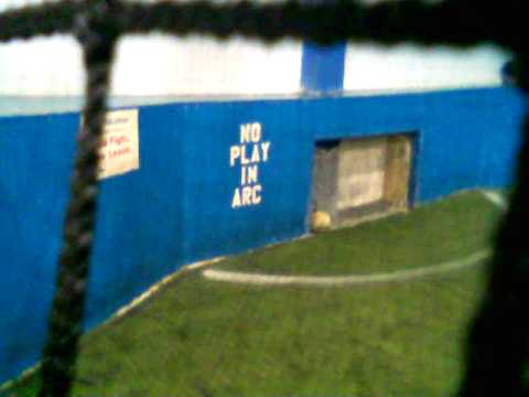 sign painted next to goal: NO PLAY IN ARC